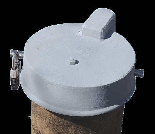 En plus de l'obturateur une tige d'acier horizontale de 12 mm de diamètre est introduite au travers du couvercle et du tuyau d'acier.